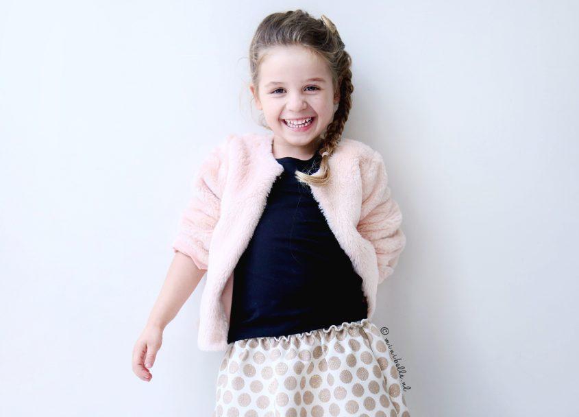 De outfit van Belle: prinsessenrok met bontjasje